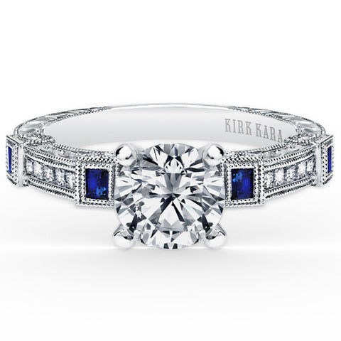 "Kirk Kara ""Carmella"" Blue Sapphire and Diamond Bezel Set Engagement Ring Featuring 0.63 Carats in 18kt White Gold with Hand Engraved Details. Style K175SDR"