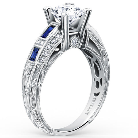 "Kirk Kara ""Charlotte"" Blue Sapphire and Diamond Engagement Ring Featuring 0.13 Carats Diamonds and 0.60 Carats of Baguette Cut Blue Sapphires in 18kt White Gold. Style SS6636-RS"