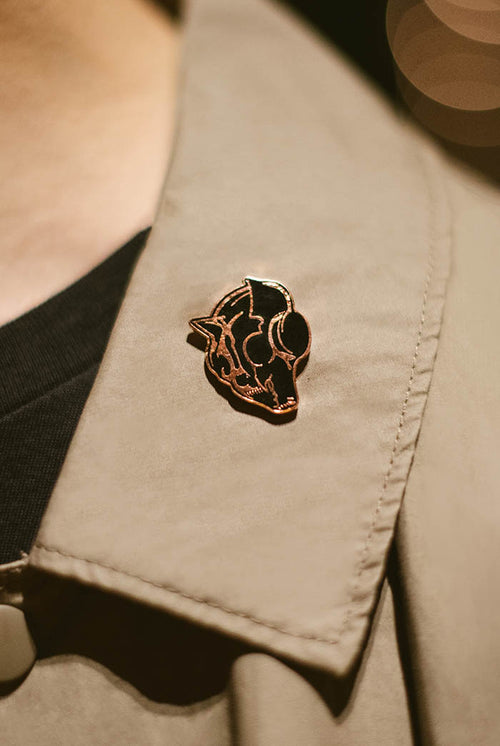 Uncaged Vol. 6 Enamel Pin