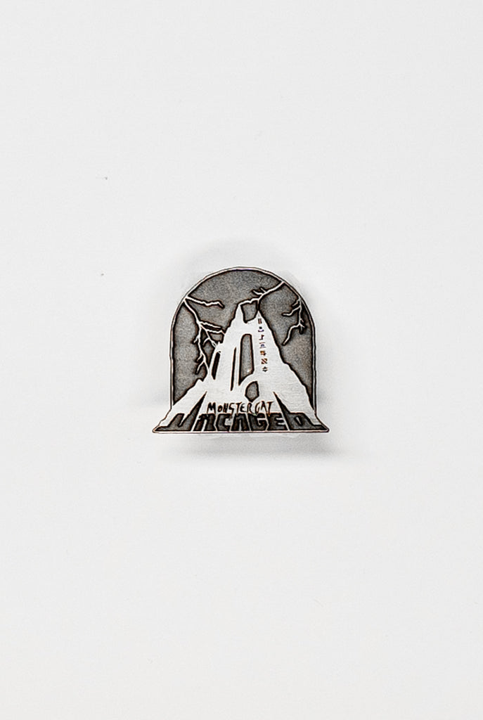 Uncaged Vol. 9 Enamel Pin