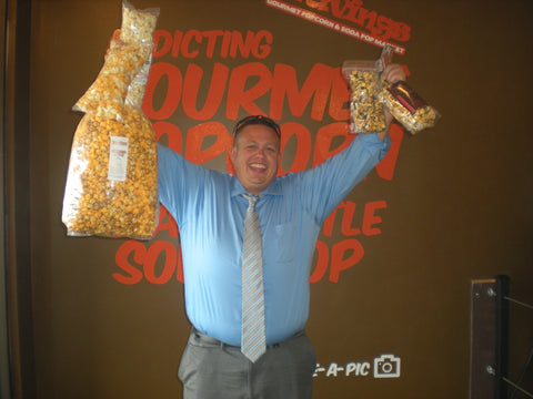 Eric wins Cravings gourmet popcorn grand prize