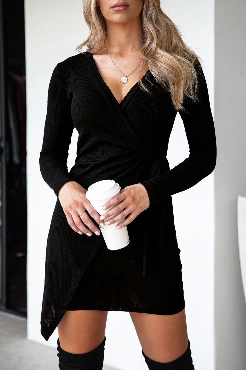 Georgia Black Ribbed Wrap Dress | That perfect dress for any occasion! The Georgia Black Ribbed Wrap Dress  features a flattering fit, hugging your body in all the right places,  an adorable tie and stretchy material so you can look and feel your  best. Pair with thigh high booties for a sexy night out look!