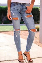 Distressed Medium Wash Denim Skinny Jeans