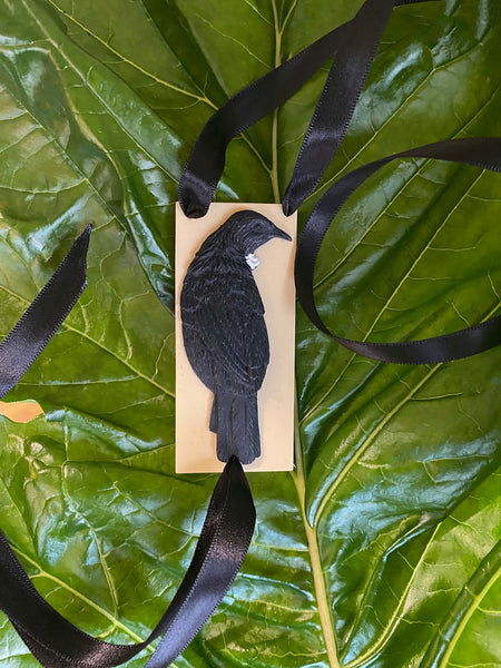New handcrafted 3-dimensional Tui on swinging on durable double-sided silk satin ribbon.  Confident spiritual warrior, the Tui brings harmony and holds power as a messenger to the gods.   Pantone resin colour option: Cream base with Black Tui- Black Ribbon by Tania Tupu