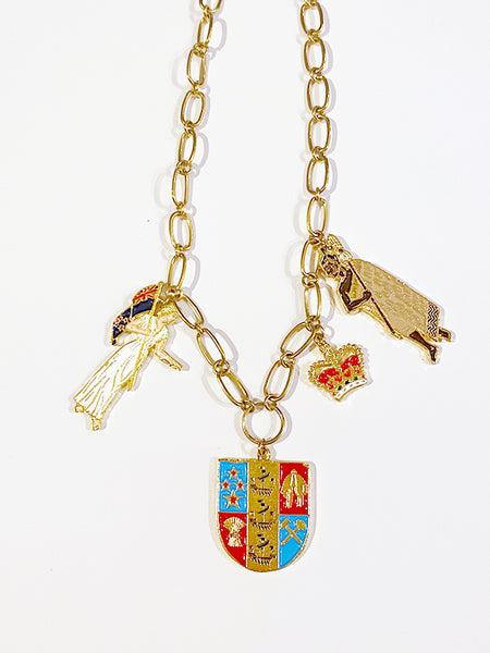 A unique deconstructed take on our very own Coat of Arms.  This necklace is truly a statement piece and comes with iconic components.   Zinc alloy, electroplated gold, and handpainted enamel charms. Made in Aotearoa Chain Length: 48cm oval belcher stainless gold chain. A standout, center of attention design patriotic to Aotearoa