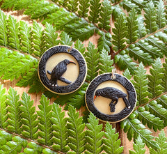 Tania Tupu's portrait earrings of the extinct Huia bird sadly silenced before our generation could hear their song.   Portrait framed Huia female and male paired together on sterling silver hooks. Wearable handcrafted 3-dimensional Huia artworks.