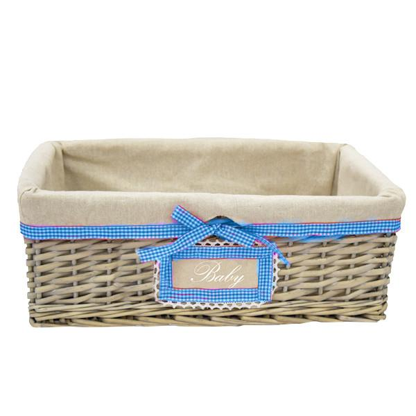 "Wicker basket with ""Baby"" label and liner"