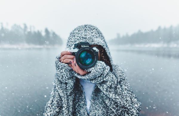 Woman taking picture in the snow