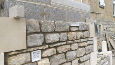 Bee Blocks in a stone wall
