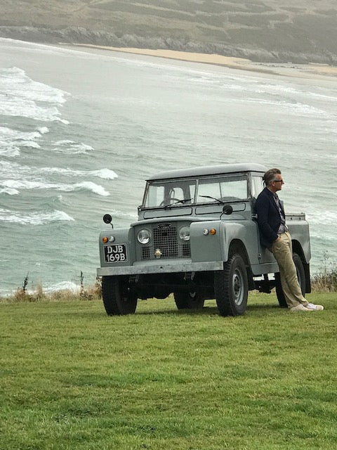 Land rover on the cornish coast with male model