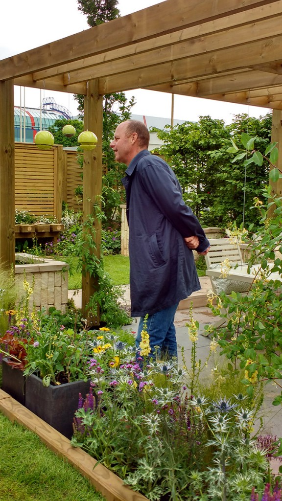joe swift from bbd gardeners world with green and blue bird feeders