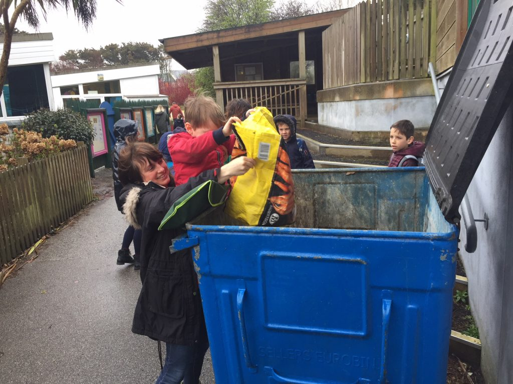 Children fill the wheelie bin at Perranporth school