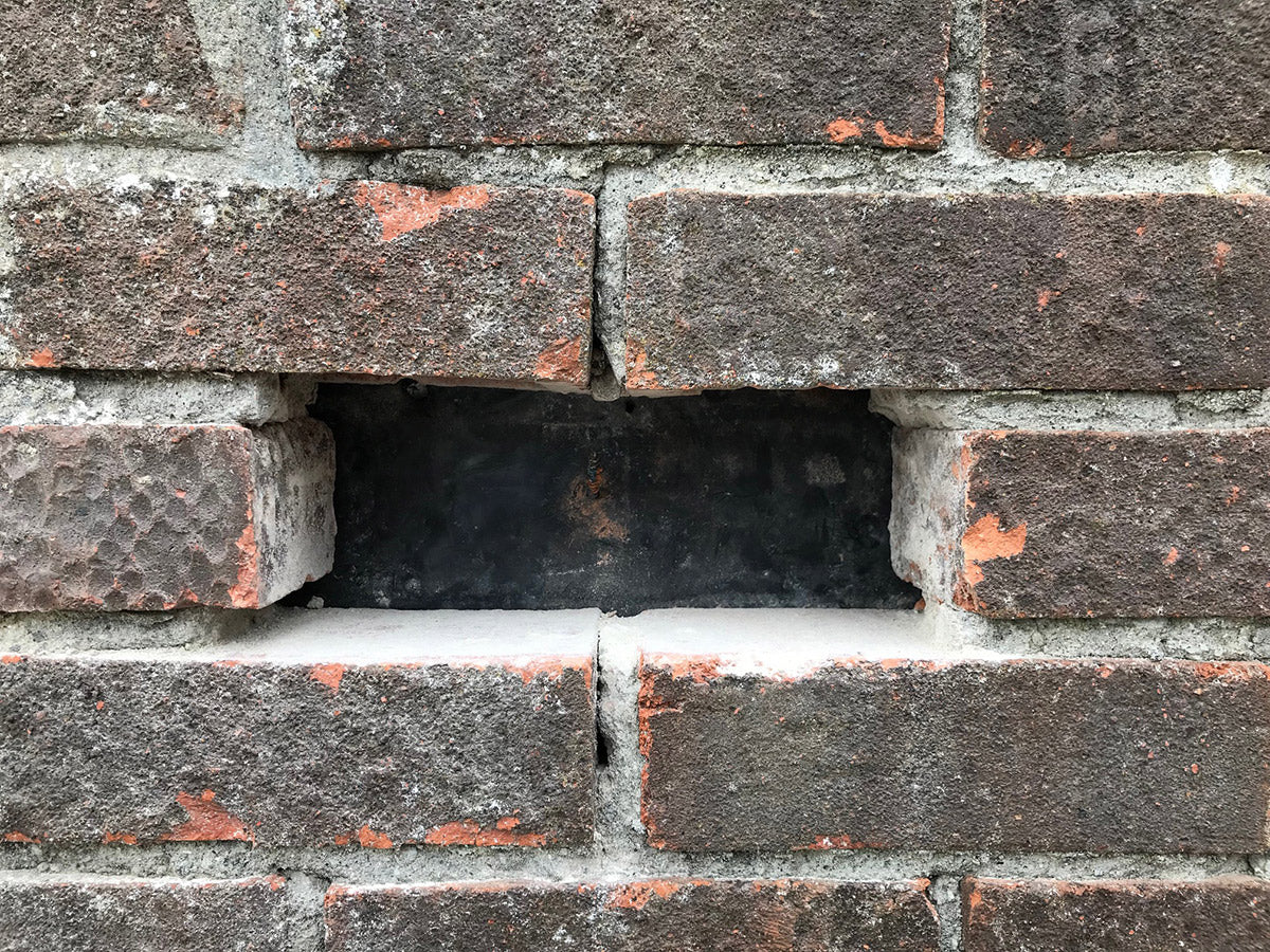brick drilled out of a brick wall