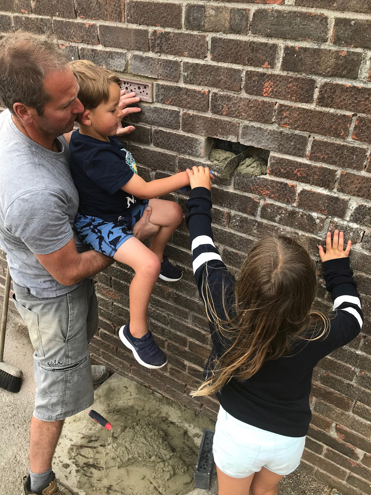 Installing a bee brick into brick wall