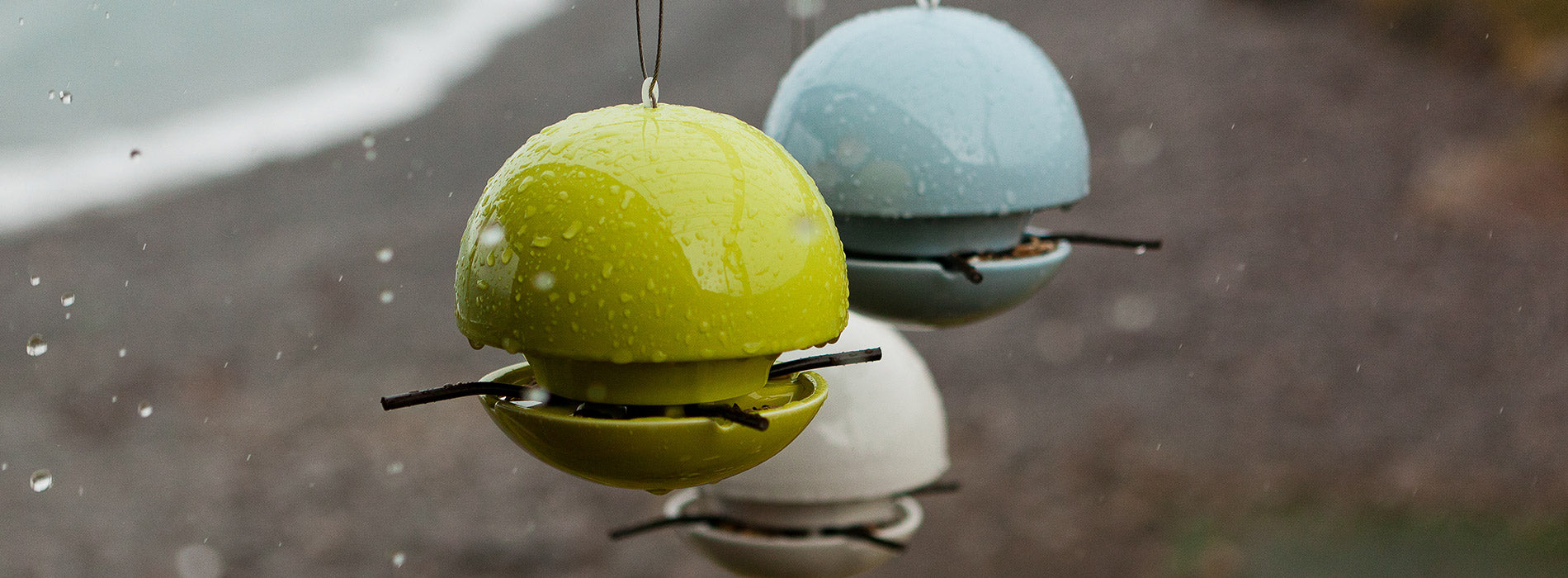 modern bird feeders in the rain