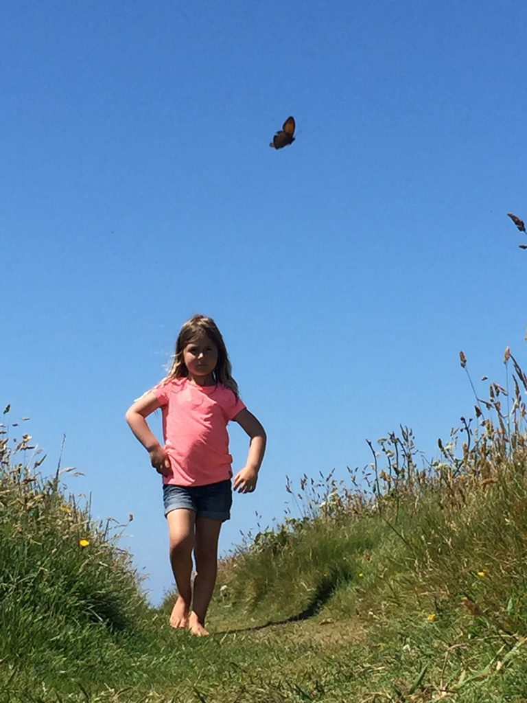 girl and a butterfly protecting our wildlife