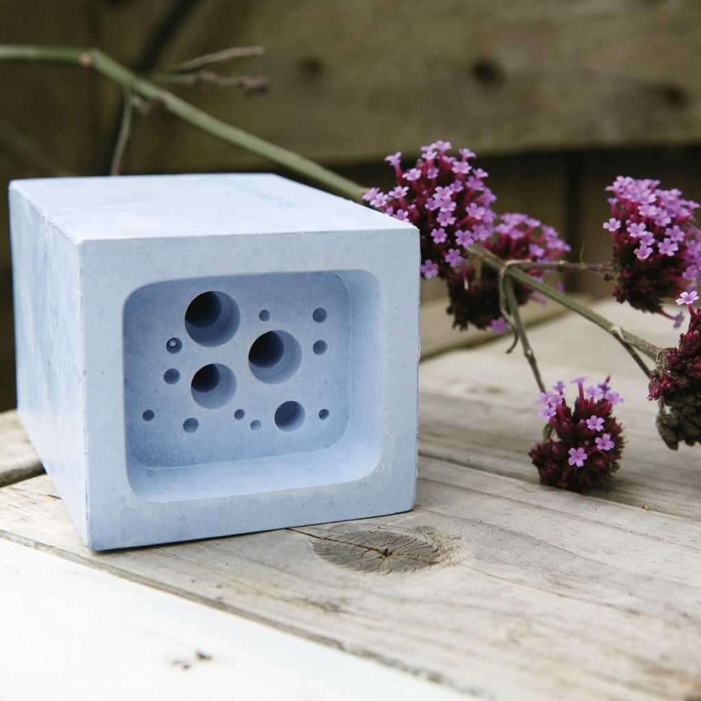 small-bee-block-by-green-and-blue-with-flowers