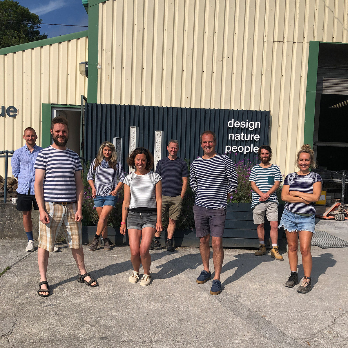 Team Green&Blue outside the workshop for solitary bee week in stripes