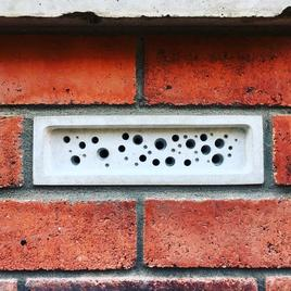 Bee Brick bee house in a brick wall
