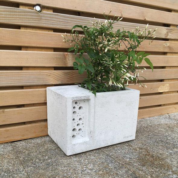 beepot bee hotel and planter in natural concrete