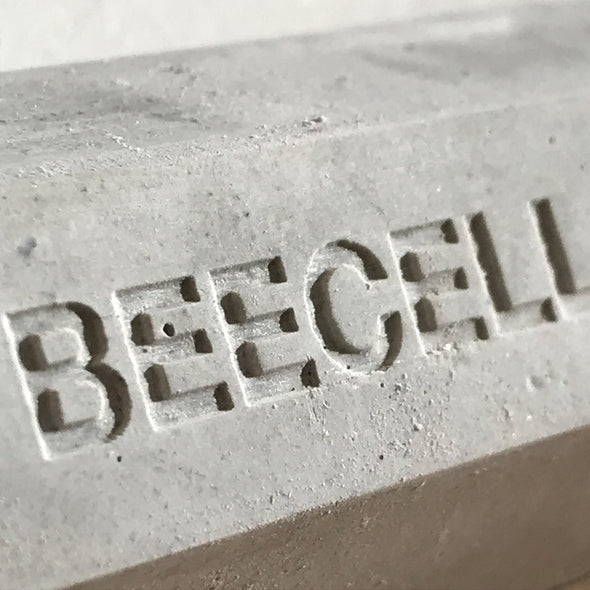 beecell bee house logo cast into concrete