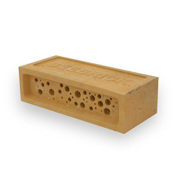 yellow bee brick bee hotel by green and blue