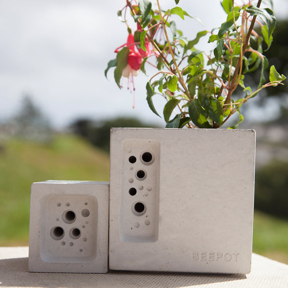 concrete bee hotel beepot mini shown with a small bee block