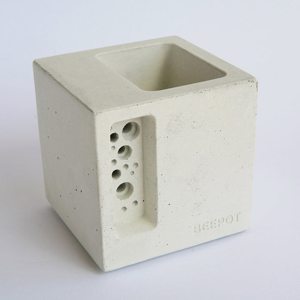 beautiful concrete bee hotel and planter