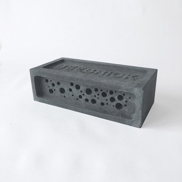 Charcoal bee brick bee hotel by green and blue