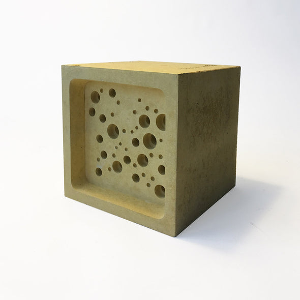 yellow bee block bee hotel by green and blue