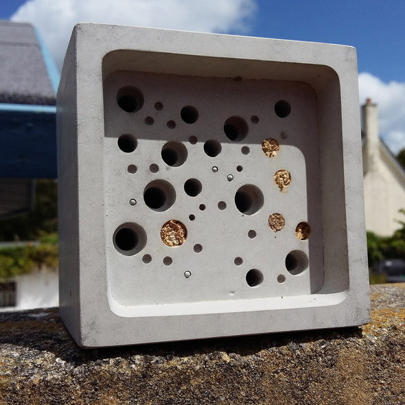 concrete bee house large bee block full of bees
