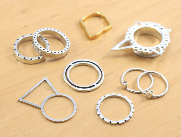 a selection of silver rings created by a silver diploma student on london jewellery school