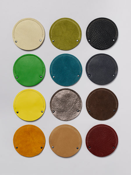 Grid of round cable cases showing 12 color variations.
