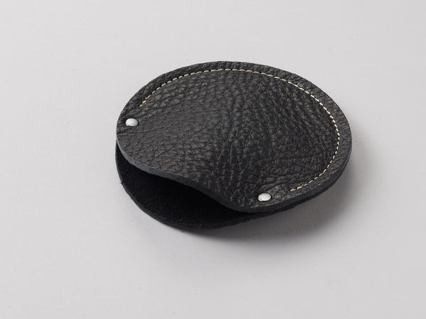 True black leather circular cable case