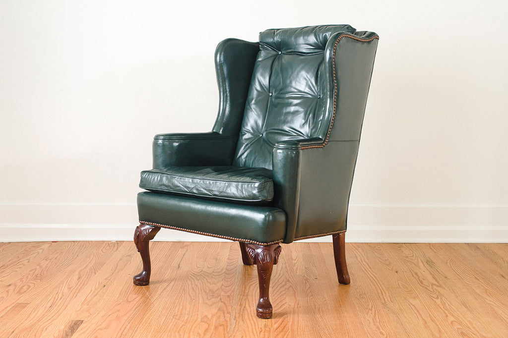 green leather wing chair