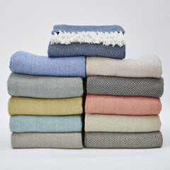 Diamond patterned blankets made from 100% recycled plastic bottles by Weaver Green