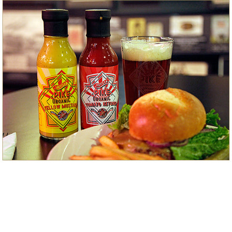 Pike Organic Yellow Mustard & Pike Organic Tomato Ketchup paired with a beer, burger, and french fries at the Pike Pub!