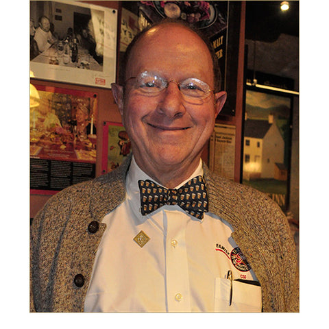 Pike Beer Bow Tie in Navy Blue — Shown on Pike President/Founder, Charles Finkel.