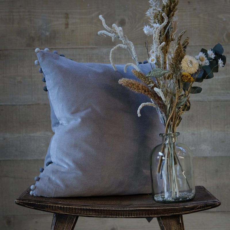 Snape Maltings Grey Velvet Cushion with Ombre Pom Poms
