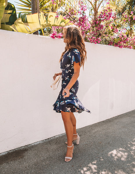 Quintessential Floral Ruched Midi Dress