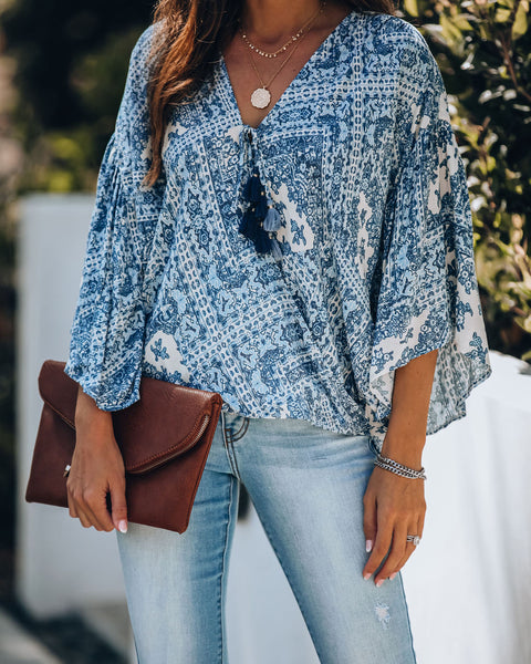 Spin Me Around Printed Surplice Tassel Top