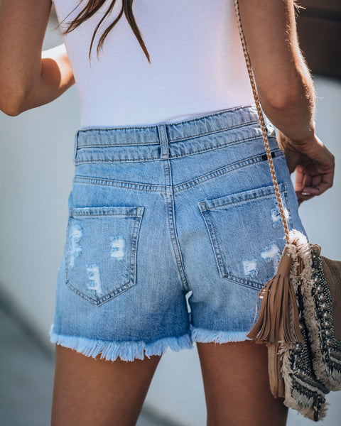 Oceanic High Rise Distressed Denim Shorts