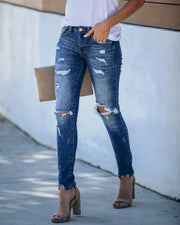 Universal Mid Rise Distressed Skinny - Dark Wash
