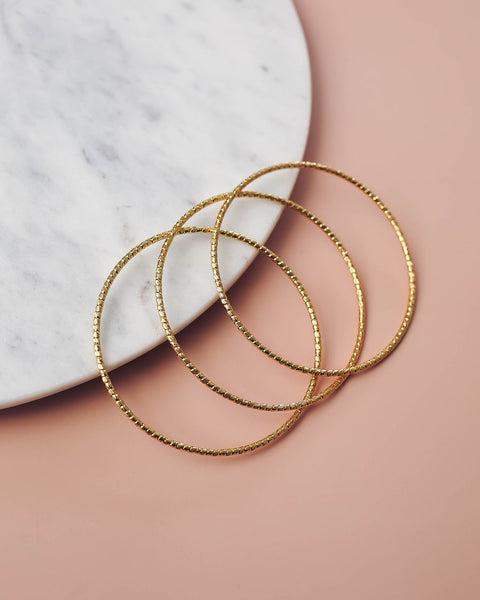 Marrin Costello – Faceted Gold Bangle Set