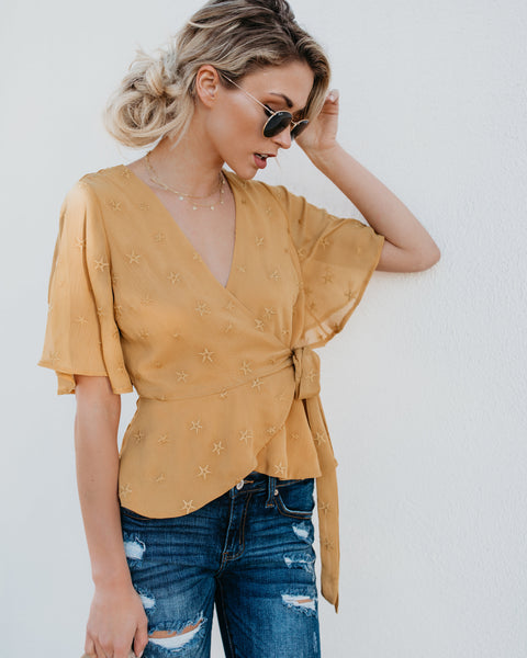 Gotta Give Embroidered Wrap Star Top - FINAL SALE