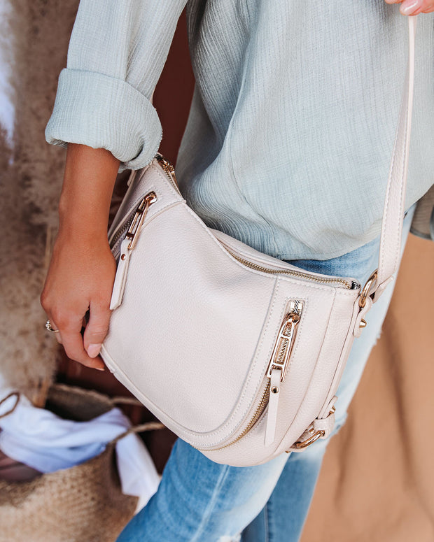 Sadie Faux Leather Crossbody Saddle Bag - Cream