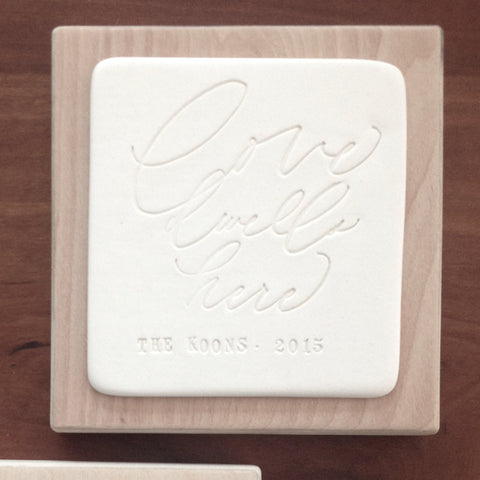 LOVE DWELLS HERE personalized wall plaque in collaboration with Chelsea Petaja