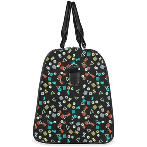 Plumskum Small / Brown Plumskum Juggle Livery Pattern Travel Bag