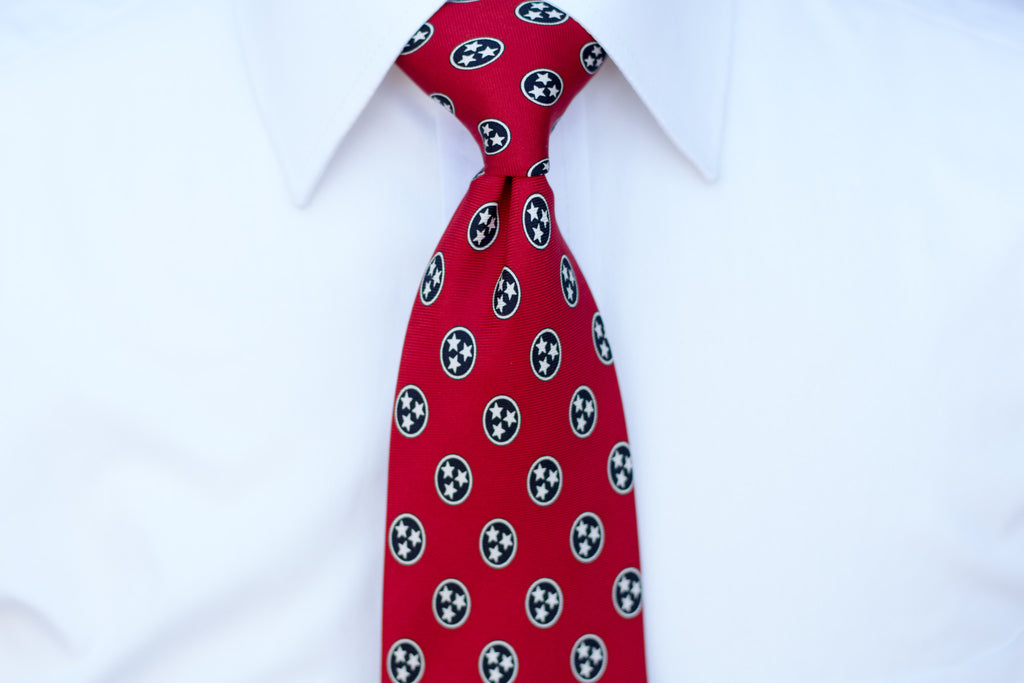 Volunteer Traditions Red Tristar Tie on neck.