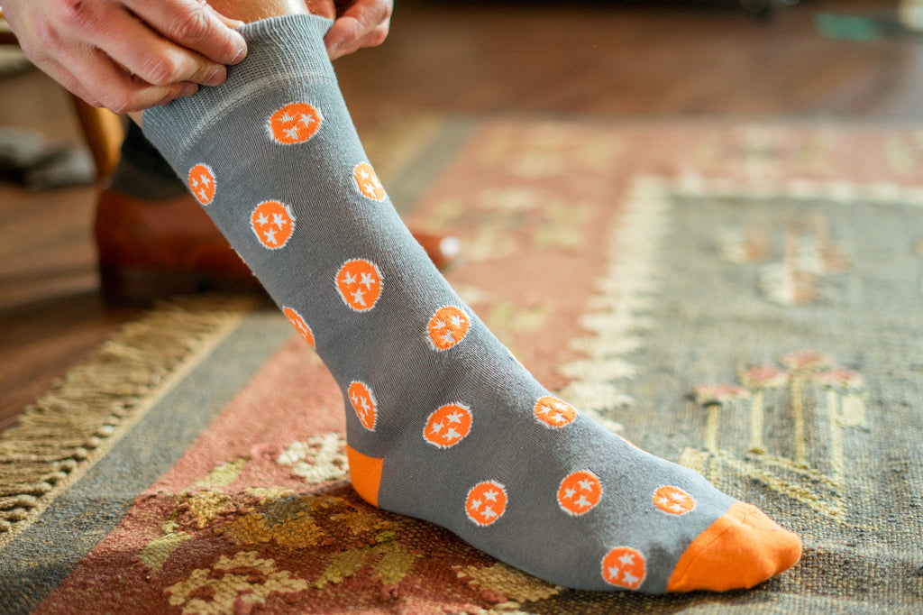 Volunteer Traditions Grey with Orange Tristar Sock on foot.